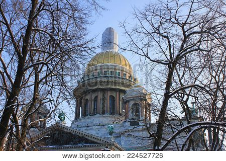 St. Isaac's Cathedral Orthodox Basilica and Museum Building in Saint-Petersburg, Russia. Famous Russian Neoclassical Style Architecture, Cultural Travel Landmark View on Sunny Day against Blue Sky.