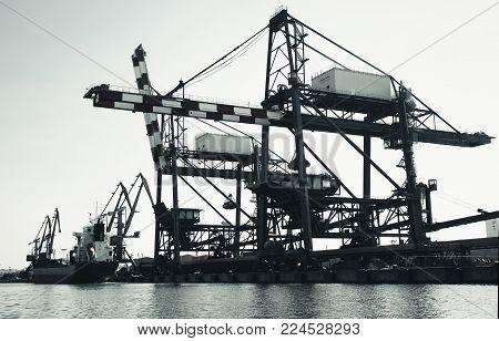 Gantry cranes in Port of Burgas, Black Sea coast, Bulgaria. Vintage toned black and white photo