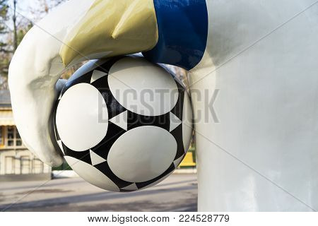 ROSTOV-ON-DON, RUSSIA - DECEMBER, 2017 back view the official mascot of the 2018 FIFA World Cup and the FIFA Confederations Cup 2017 wolf Zabivaka with the ball on the Theater Square in Rostov-on-Don