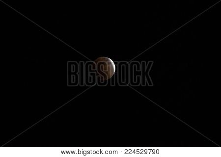 'Super Blue Blood Moon' Eclipse, 31 January 2018 Japan. Slightly before it goes in to total lunar eclipse. Eclipse during a blue moon and a supermoon.