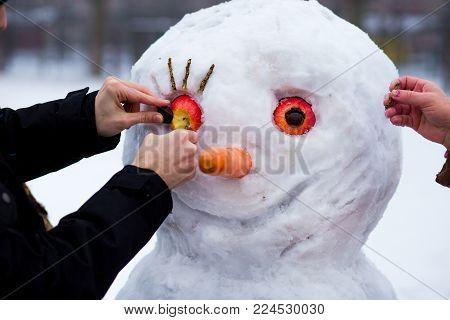 Happy Man Sculpt A Big Real Snowman. Funny Man Has Fun In Winter Park, Wintertime