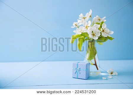 Two Purple Chrysanthemum Flowers On Violet Closed Notebook On White Wooden Background