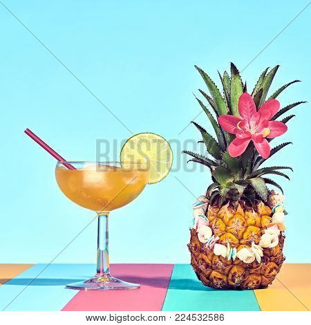 Tropical Pineapple with Cocktail on Beach.. Bright Summer Color. Hot Summer Vibes. Trendy fashion Style. Creative Art. Fun Summer party Mood. Minimal