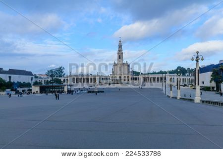 FATIMA, PORTUGAL - DECEMBER 27, 2017: Scene of the Sanctuary of Our Lady of Fatima, with pilgrims and visitors, in Fatima, Portugal