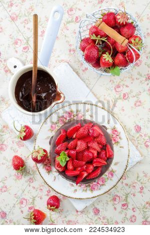 Traditional chocolate strawberry cheesecake with fresh strawberries as top view on a plate