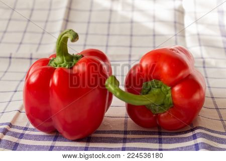 Raw food bell pepper. Red bell pepper isolated with square pattern on cloth.
