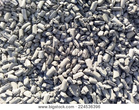 Iron in briquettes piled high in the harbor. raw steel.