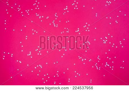 Gold metallic stars on a pink red green background