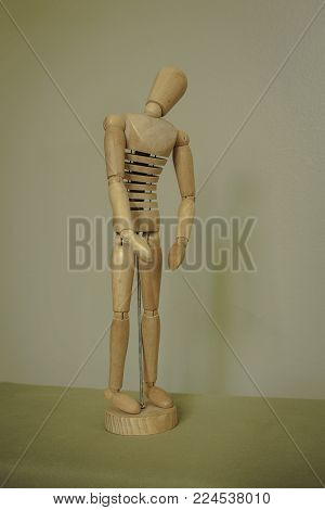 Wooden artist's mannequin in a standing pose