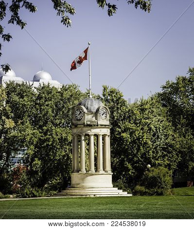 KITCHENER, CANADA - OCTOBER 24, 2016: This clock tower was removed from Kitchener's old city hall during demolition in 1973. It has been preserved and now stands in a prominent location in Kitchener's Victoria Park.