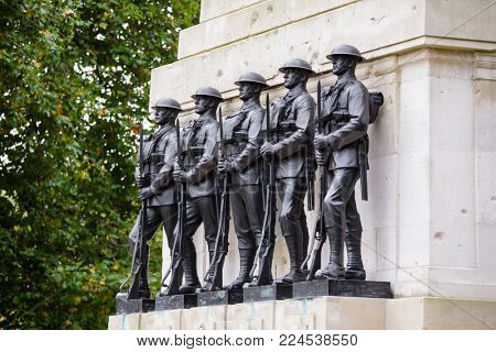 LONDON, UK - OCTOBER 28, 2012: Five bronze sculptures of soldiers at Guards Memorial also known as the Guards Division on Horse Guards Road
