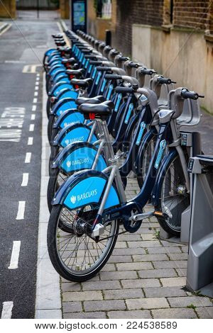 LONDON, UK - NOVEMBER 10, 2012: Row of Blue bikes used in a public bicycle hire scheme Barclays Cycle Hire also known as Boris Bikes