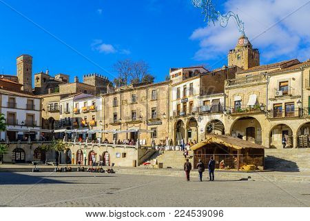 TRUJILLO, SPAIN - DECEMBER 30, 2017: Scene of Plaza Mayor, with locals and visitors, in Trujillo, Extremadura, Spain
