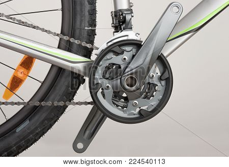 Bicycle crank set, chain and front derailleur,close up view, studio photo.