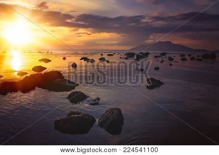 Sunset the ocean as seen from the beach in Flores, East Nusa Tenggara, Indonesia, Asia