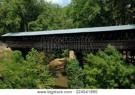Clarkson Covered Bridge Spans Crooked Creed Near Cullman, Alabama.  It Is An Extra Long Wooden Bridg