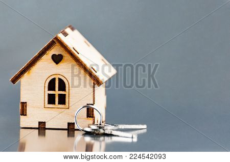 The little house next to the keys. Symbol of hiring a house for rent, selling a home, buying a home, a mortgage.