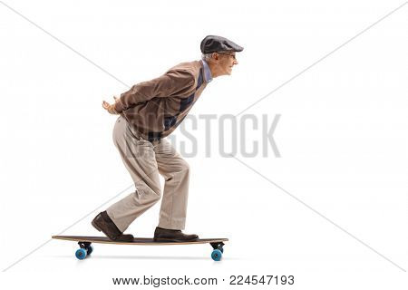 Full length profile shot of a senior riding a longboard isolated on white background
