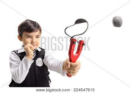 Schoolboy shooting a slingshot isolated on white background
