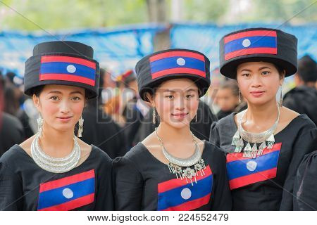 Luang Prabang, Laos - December 19, 2015: Women of local mountaineer tribe 'Hmong' are dressing with traditional costume in Luang Prabang, Laos.