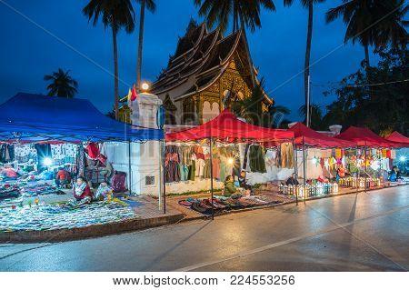 Luang Prabang, Laos - December 18, 2015: A famous walking street in the world heritage site, Luang Prabang, Laos.