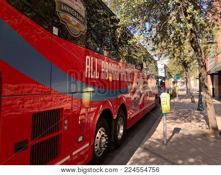PHOENIX, AZ, USA - DECEMBER 14, 2017:  Charter and school buses closely parked for a special event in city downtowm
