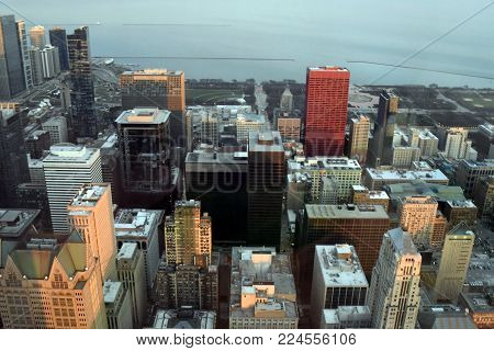 CHICAGO, Illinois, USA, The loop and Lake Michigan, along with Chicago downtown business district cityscape landscape at sunset with sunlight reflecting off of the buildings