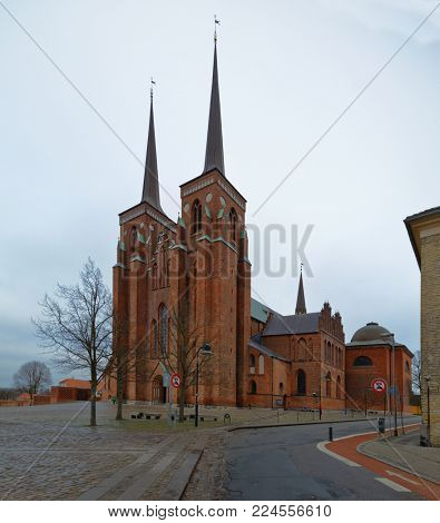 ROSKILDE, DENMARK - DECEMBER 28, 2016: Roskilde Cathedral where 39 kings and queens of Denmark lie buried. The Cathedral is a UNESCO World Heritage site