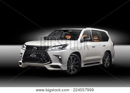 Novosibirsk, Russia - December 3, 2017: Lexus 570 side view Photography of a jeep on a black isolated background