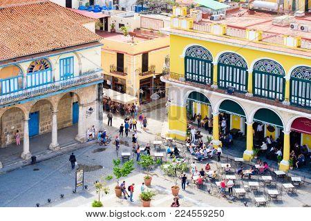 HAVANA,CUBA - JANUARY 27,2018 : Colonial buildings and outdoor restaurant in Old Havana