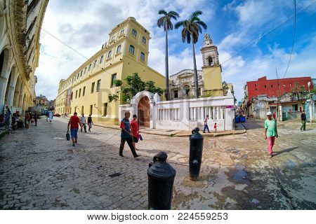 HAVANA,CUBA - JANUARY 27,2018 : Street scene in Old Havana with people and decaying buildings