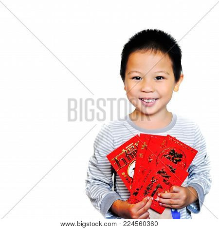Closed up Smiling asian child is holding red packets and Chinese word all meaning have a good luck, isoleted on white backgrond, chinese new year concept
