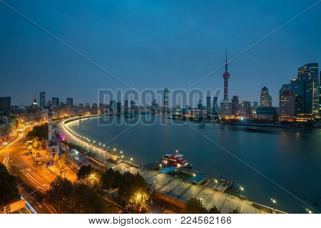 Shanghai, China - Nov 15, 2017: The Bund and Pudong area of Shanghai at sunrise. The Bund is a waterfront area in central Shanghai with many historical buildings built by former foriegn settlements.