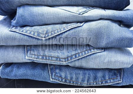 Stack of Blue and Black Jeans, Closeup