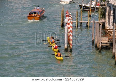 Venice, Italy - August 13, 2016: People on kayaks in Grand Canal