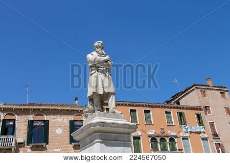 Venice, Italy - August 13, 2016: Statue of Nicolo Tommaseo on St. Stephen's square (campo Santo Stefano)