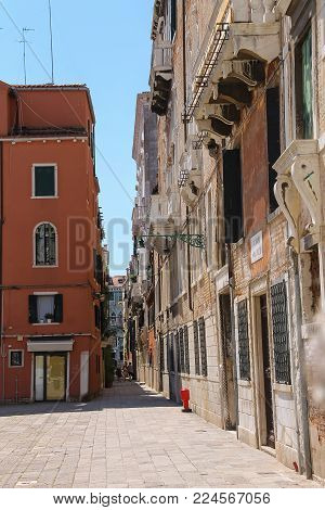 Venice, Italy - August 13, 2016: Tourists walking in street of city centre