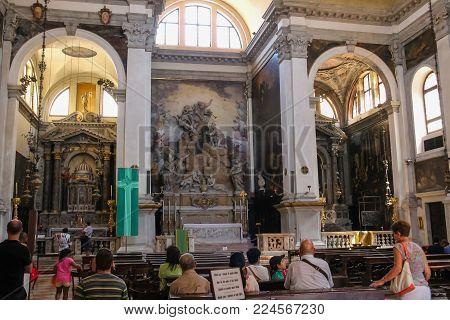 Venice, Italy - August 13, 2016: People inside of Saint Moses church (Basilica di San Moise)