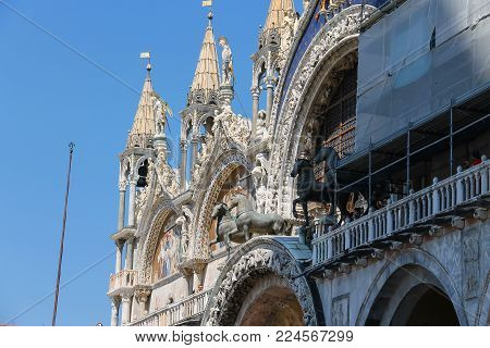 Venice, Italy - August 13, 2016: Tourists on famous St. Mark's Square. View of San Marco Basilica