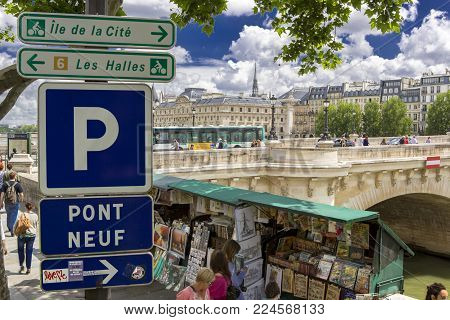 Paris, France - 14 June, 2013: Traditional Bouquiniste booth on the edge of the Seine. The Bouquinistes sell used and antique books as well as souvenirs. Paris.France.