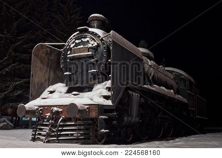 Old Steam Engine Covered With Snow