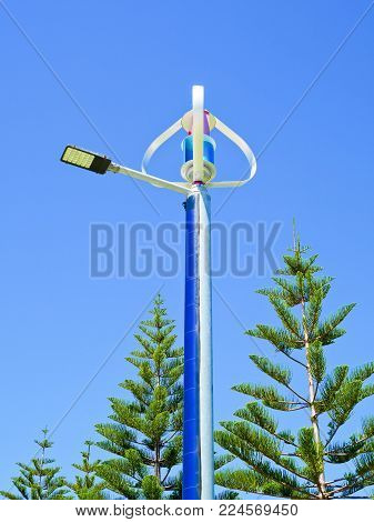 Solar And Wind Powered Street Lights on clear blue sky