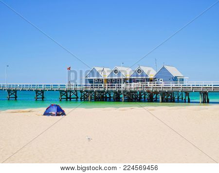 Busselton Jetty on a sunny day with tourists in front of interpretive centre