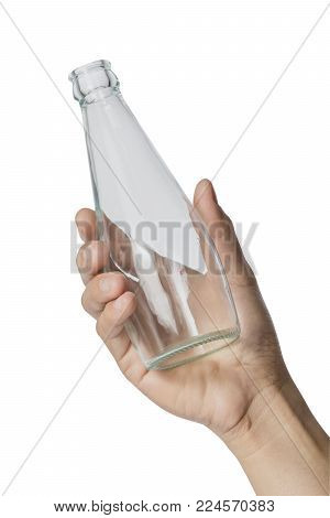 Woman's Hand Holding Empty Glass Bottle Transparent On White Background, File Contains A Clipping Pa