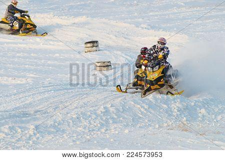 Tyumen, Russia - December 26. 2009: Sport snowmobile racing on championship of Ural region. Sportsmen on snowmobiles on track