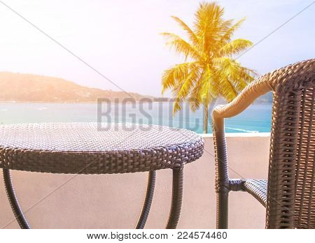 rattan chair set on balcony hotel room with  natural view