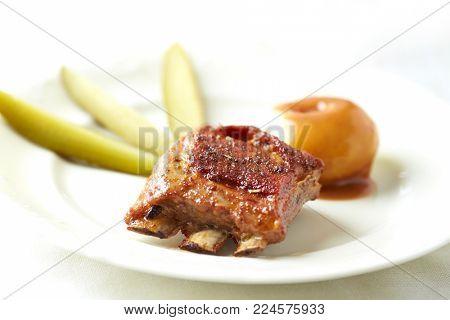 Pork ribs with gherkins and  potato dumplings