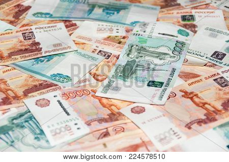 Scattered rouble diferent banknotes close up view