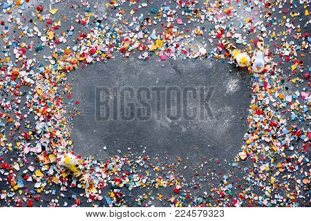 Easter background with colorful crushed eggshell and frame with blank space for text