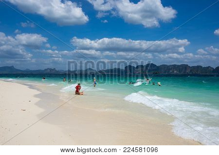 CRABI PROVINCE, THAILAND - FEBRUARY 02, 2015: Tourists swimming in turquoise water of  Andaman sea at Krabi province, Thailand